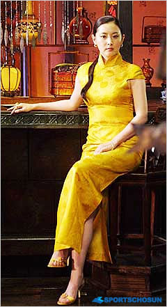 Lee Young Ae in a yellow chinese cheongsam